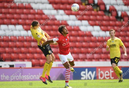 Barnsley's Jacob Brown holds off Murray Wallace.