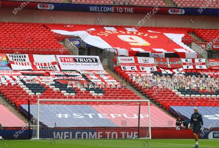 A giant shirt in memory of former Exeter player Adam Stansfield above the fan's faces on seats, inside Wembley Stadium, before the SkyBet League 2 play off final between Exeter City and Northampton Town