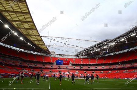 The Exeter team warm up inside Wembley Stadium, before the SkyBet League 2 play off final between Exeter City and Northampton Town