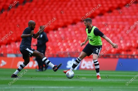 Pierce Sweeney and Nigel Atangana of Exeter City warm up before the start of the SkyBet League 2 play off final between Exeter City and Northampton Town