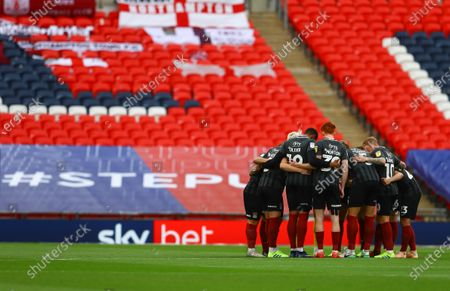 The Northampton Town team huddle before the start of the Sky Bet League 2 Play off Final between Exeter City and Northampton Town