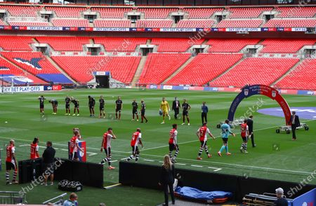 The players from both teams walk out onto the Wembley pitch before the start of the Sky Bet League 2 Play off Final between Exeter City and Northampton Town