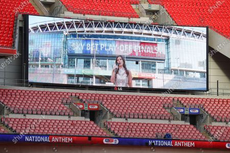 Shown on the giant screen, the national anthem is sung before the start of the Sky Bet League 2 Play off Final between Exeter City and Northampton Town