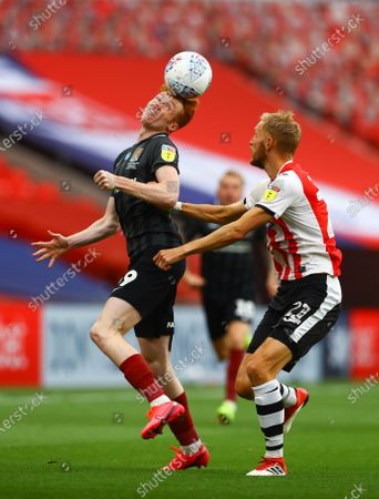 Callum Morton of Northampton Town and Dean Moxey of Exeter City