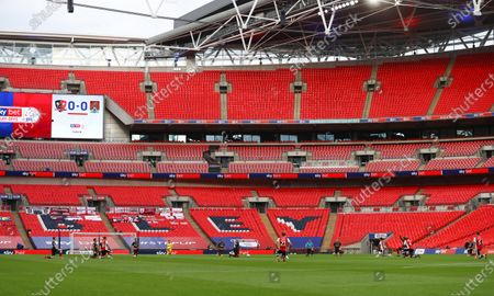 The players from both teams take a knee inside Wembley Stadium before the start of the Sky Bet League 2 Play off Final between Exeter City and Northampton Town