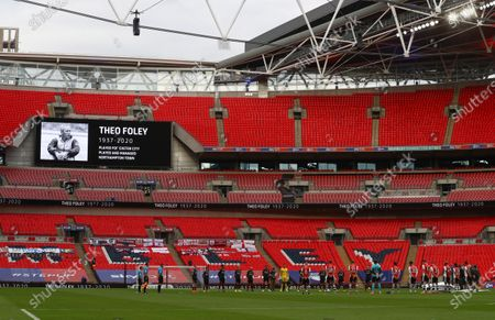 Players from both teams stand for a minute's silence for Theo Foley before the start of the Sky Bet League 2 Play off Final between Exeter City and Northampton Town