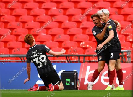 Ryan Watson of Northampton Town celebrates scoring the opening goal during the League 2 Play Off final
