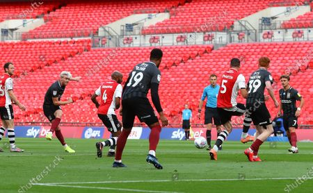 Ryan Watson of Northampton Town scores the opening goal during the League 2 Play Off final