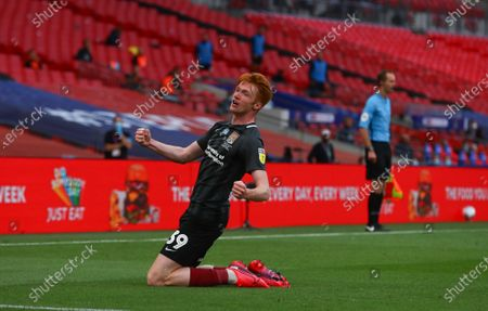 Callum Morton of Northampton Town celebrates scoring the second goal during the League 2 Play Off final