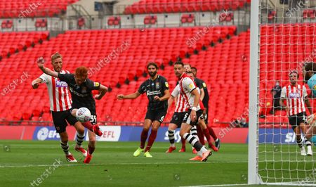 Callum Morton of Northampton Town scores the second goal to make to score 2-0 during the League 2 Play Off final