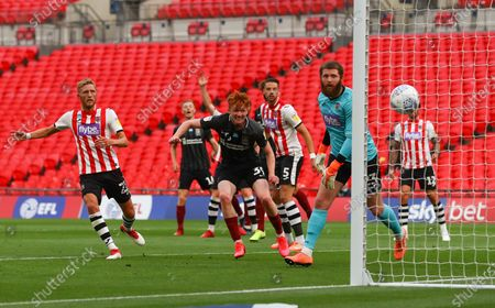 Callum Morton of Northampton Town scores the second goal past Jonathan Maxted of Exeter City to make to score 2-0 during the League 2 Play Off final