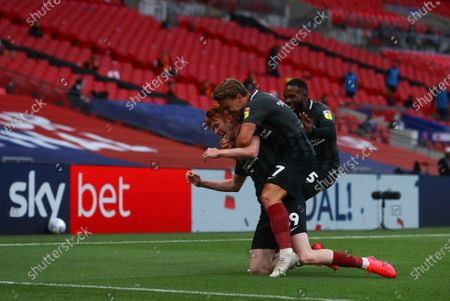 Callum Morton of Northampton Town, with Sam Hoskins,  celebrates scoring the second goal during the League 2 Play Off final