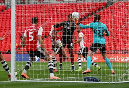 Exeter City goalkeeper Jonathan Maxted makes a save on the goalline