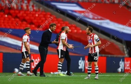 Exeter City manager Matt Taylor urges on his players during the match between Exeter City and Northampton Town for the League 2 Play Off Final