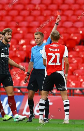 Dean Moxey of Exeter City is shown a red card by referee Michael Salisbury during the Sky Bet League 2 Play off Final between Exeter City and Northampton Town