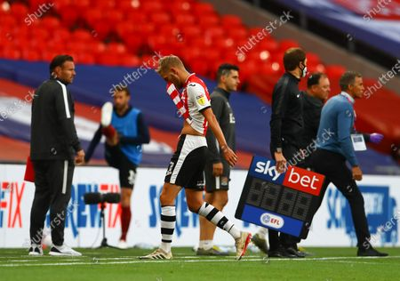 Dean Moxey of Exeter City walks off the pitch after receiving a red card during the Sky Bet League 2 Play off Final between Exeter City and Northampton Town
