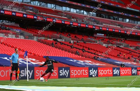Mark Marshall of Northampton Town takes a corner inside an empty Wembley Stadium during the Sky Bet League 2 Play off Final between Exeter City and Northampton Town