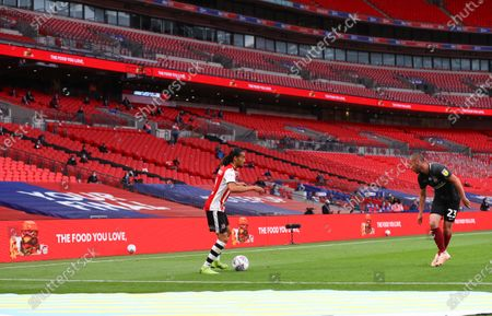 Action inside an empty Wembley Stadium, with Just Eat branding, during the Sky Bet League 2 Play off Final between Exeter City and Northampton Town