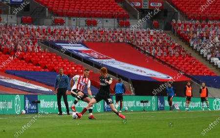 Action inside an empty Wembley Stadium, with Mind branding, during the Sky Bet League 2 Play off Final between Exeter City and Northampton Town