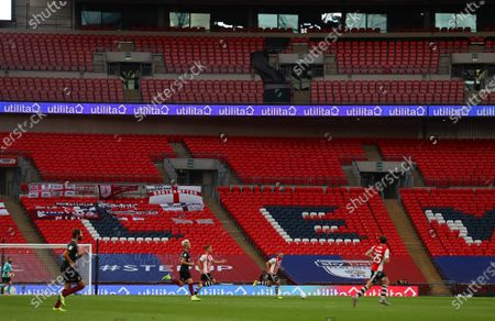 Action inside an empty Wembley Stadium, with Utilita branding, during the Sky Bet League 2 Play off Final between Exeter City and Northampton Town