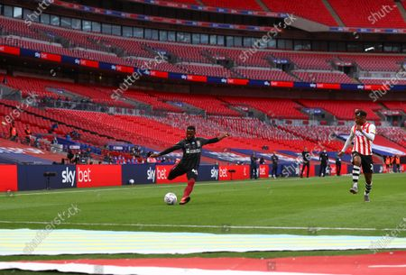 Action inside an empty Wembley Stadium, with Sky Bet branding, during the Sky Bet League 2 Play off Final between Exeter City and Northampton Town