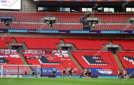 Action inside an empty Wembley Stadium, with Leasing.com branding, during the Sky Bet League 2 Play off Final between Exeter City and Northampton Town