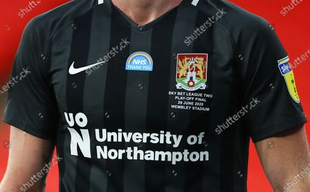 An NHS Thank you message on a Northampton shirt during the Sky Bet League 2 Play off Final between Exeter City and Northampton Town