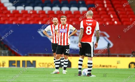 Dejected Exeter City players, Archie Collin and Nicky Law after conceding the fourth goal during the Sky Bet League 2 Play off Final between Exeter City and Northampton Town