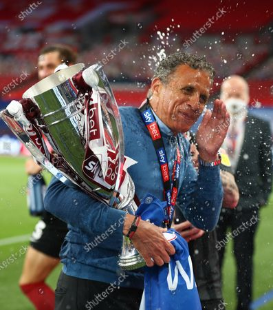Northampton Town manager Keith Curle celebrates with the trophy after his team beats Northampton Town 4-0 in the Sky Bet League Two Play off Final and securing promotion to League One.