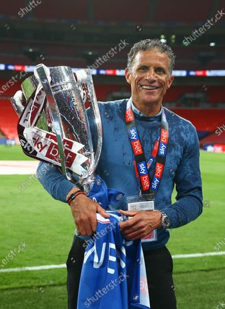 Northampton Town manager Keith Curle stands with the League Two play off trophy after his team beat Exeter City 4-0 in the Sky Bet Play off Final and securing promotion to League One.