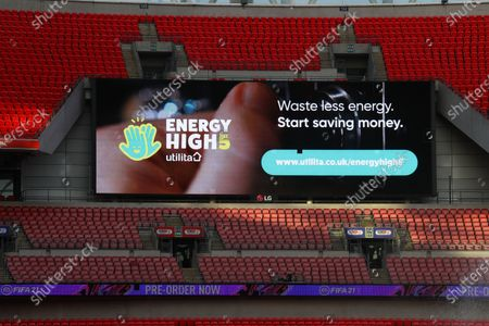 The giant screen shows Utilita branding at Wembley Stadium during the Sky Bet League 2 Play off Final between Exeter City and Northampton Town