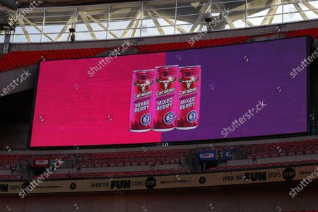 The giant screen shows Carabao Mixed Berry drink  branding at Wembley Stadium during the Sky Bet League 2 Play off Final between Exeter City and Northampton Town