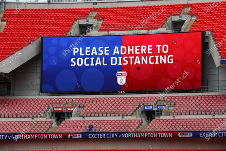 The giant screen shows Sky Bet Social Distancing branding at Wembley Stadium during the Sky Bet League 2 Play off Final between Exeter City and Northampton Town
