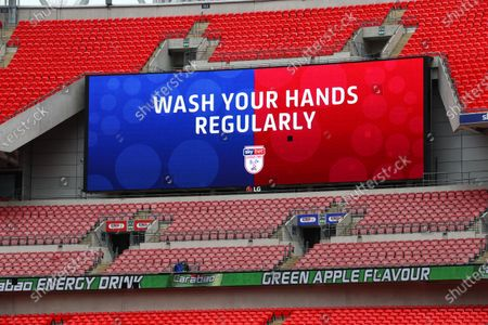 The giant screen shows Sky Bet Wash Your Hands branding at Wembley Stadium during the Sky Bet League 2 Play off Final between Exeter City and Northampton Town