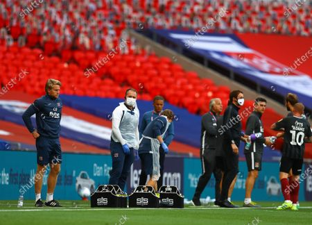 Protective masks being worn on the touchline inside Wembley Stadium, with Leasing.com branding, during the Sky Bet League 2 Play off Final between Exeter City and Northampton Town