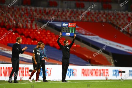 The substitute board, with Screwfix branding, during the Sky Bet League 2 Play off Final between Exeter City and Northampton Town