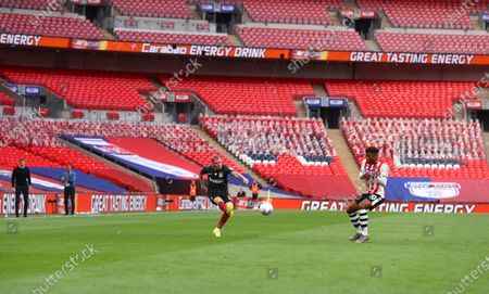 Action inside Wembley Stadium, with Carabao Orange branding, during the Sky Bet League 2 Play off Final between Exeter City and Northampton Town
