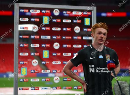Callum Morton of Northampton Town stands in front of the Man of the Match board after his team beat Exeter 4-0 the Sky Bet League 2 Play off Final