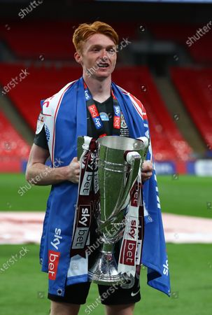Callum Morton of Northampton Town celebrates with the trophy after his team beat Exeter 4-0 the Sky Bet League 2 Play off Final