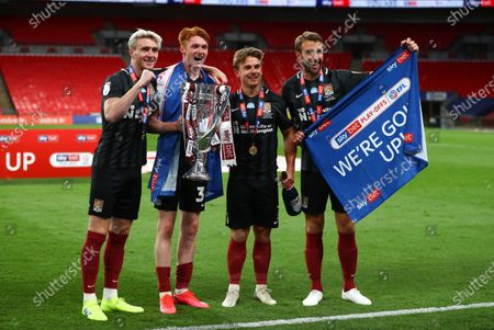 Northampton goalscorers Callum Morton, Ryan Watson, Sam Hoskins and Andy Williams celebrate together after they secure promotion to League One after beating Exeter City 4-0 in the Sky Bet Play off final