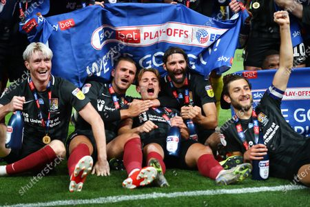 Ryan Watson, Harry Smith, Sam Hoskins and Jordan Turnbull Northampton Town celebrate  after his team beat Exeter 4-0 the Sky Bet League 2 Play off Final