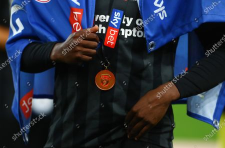 A Northampton Town winner's medal after they beat Exeter City 4-0 in the Sky Bet Play off Final and securing promotion to League One.