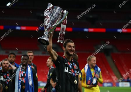 Northampton Town captain Charlie Goode celebrates with the trophy after his team beat Exeter 4-0 the Sky Bet League 2 Play off Final