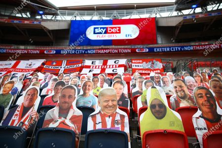 Faces on seats of the Exeter City fans, including Donald Trump, with Sky Bet EFL branding, inside Wembley Stadium, before the SkyBet League 2 play off final between Exeter City and Northampton Town