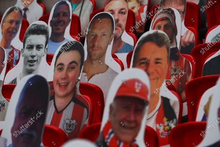 Faces on seats of the Exeter City fans, including Coldplay lead singer Chris Martin, inside Wembley Stadium, before the SkyBet League 2 play off final between Exeter City and Northampton Town