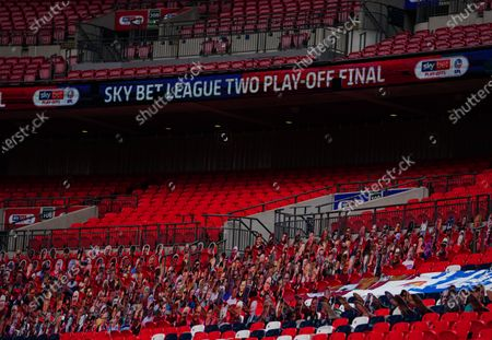A view inside Wembley Stadium of faces on seats, with Sky Bet EFL branding, before the SkyBet League 2 play off final between Exeter City and Northampton Town