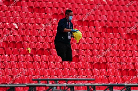 The ball is wiped down after being collected from the stands during the League 2 Play Off final between Exeter and Northampton