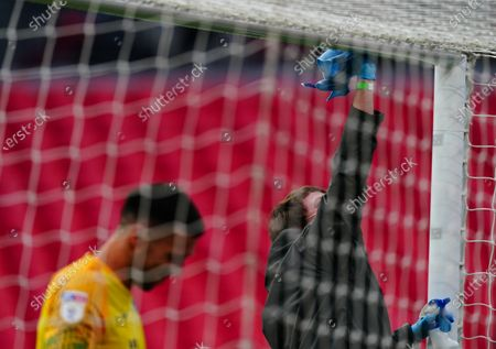 The goal posts are wiped down during a drinks break