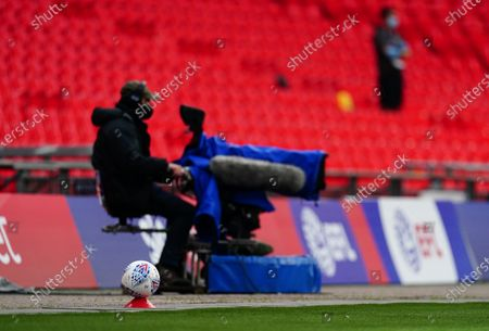 A spare bal rests at the side of the pitch during the match between Exeter City and Northampton Town for the League 2 Play Off Final