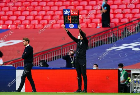 The Sky Bet EFL substitutes board held up by the fourth official Leigh Doughty during the match between Exeter City and Northampton Town for the League 2 Play Off Final